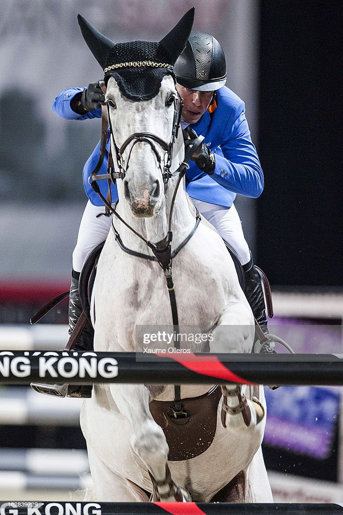 Gerco Schroder of The Netherlands rides New Orleans at the Prix Artemide during the Longines Hong Kong Masters International Show Jumping at Asia World Expo on February 28, 2013 in Hong Kong, Hong Kong.