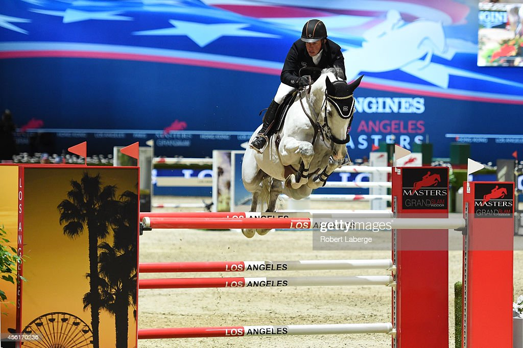 Gerco Schroder rides Cognac Champblanc during the City of Los Angeles Trophy class as part of the Longines Los Angeles Masters at Los Angeles Convention Center on September 26, 2014 in Los Angeles, California.