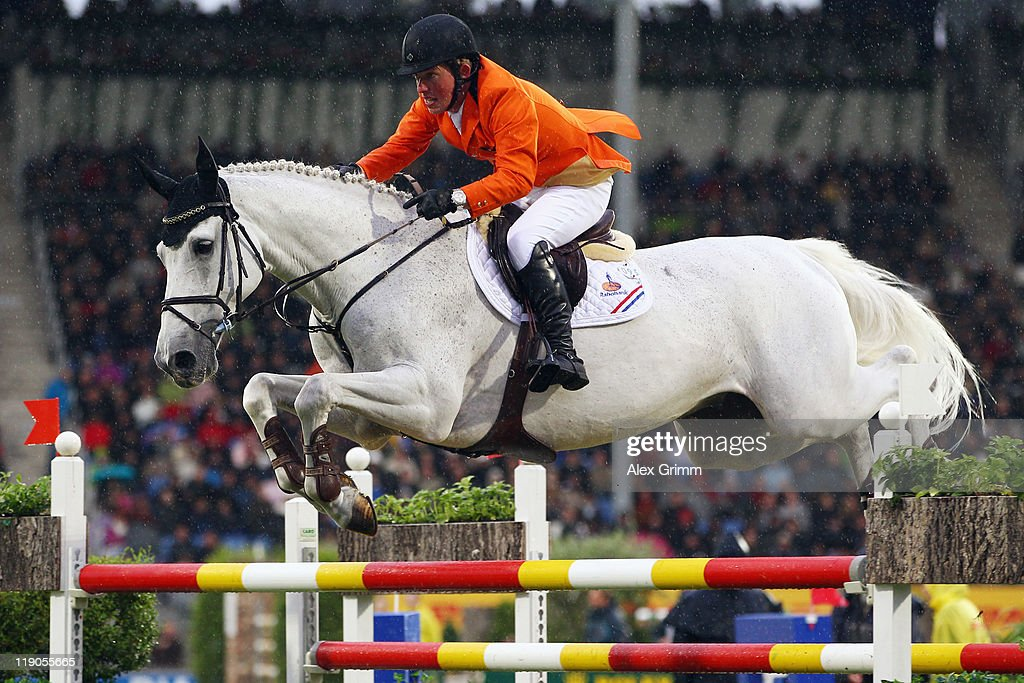 <a gi-track='captionPersonalityLinkClicked' href=/galleries/search?phrase=Gerco+Schroeder&family=editorial&specificpeople=629063 ng-click='$event.stopPropagation()'>Gerco Schroeder</a> of the Netherlands competes on his horse Eurocommerce New Orleans during the first round of the Nations Cup team jumping competition at the CHIO on July 14, 2011 in Aachen, Germany.