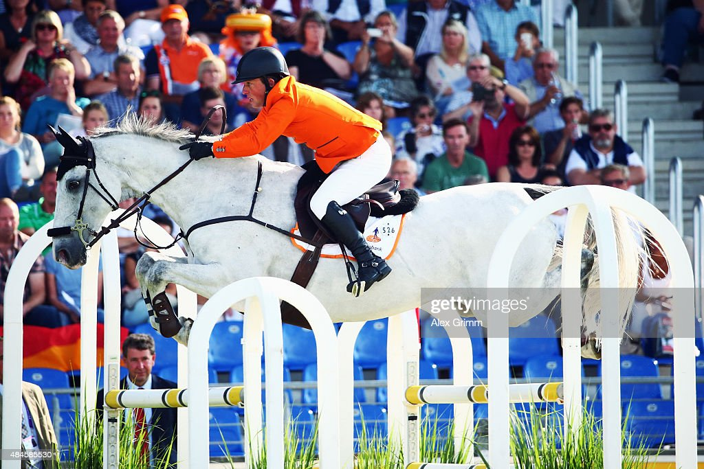 <a gi-track='captionPersonalityLinkClicked' href=/galleries/search?phrase=Gerco+Schroeder&family=editorial&specificpeople=629063 ng-click='$event.stopPropagation()'>Gerco Schroeder</a> of the Netherlands competes on his horse Glock's Cognac Champblancduring the Mercedes-Benz Prize Team Show Jumping competition on Day 9 of the FEI European Equestrian Championship 2015 on August 20, 2015 in Aachen, Germany.