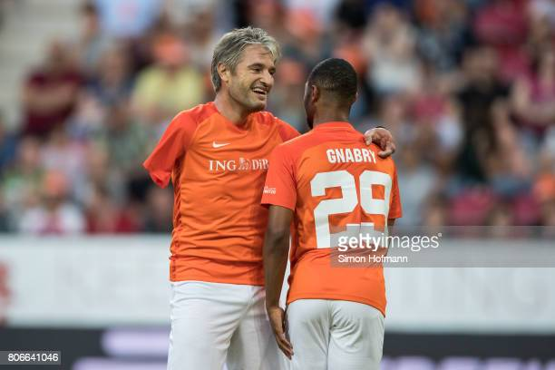 Gerd Schoenfelder of Nowitzki All Stars hugs Serge Gnabry during the Champions for Charity Friendly match at Opel Arena on July 3 2017 in Mainz...
