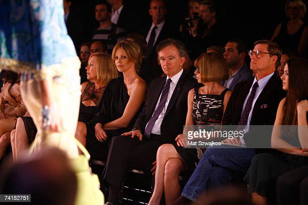 Gerda Theron Charlize Theron Bernard Arnault and Anna Wintour attend the Dior 2008 Cruise collection fashion show on May 14 2007 in New York City