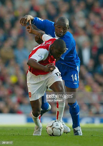 Geremi of Chelsea tries to tackle Lauren of Arsenal during the FA Barclaycard Premiership match between Arsenal and Chelsea on October 18 2003 at...