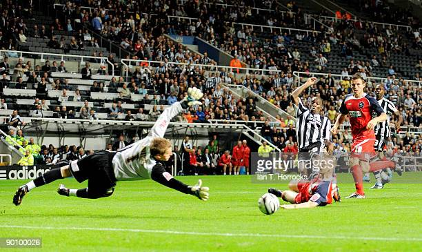 Geremi of Newcastle scores his team's second goal during the Carling Cup 2nd round match between Newcastle United and Huddersfield Town at St James'...