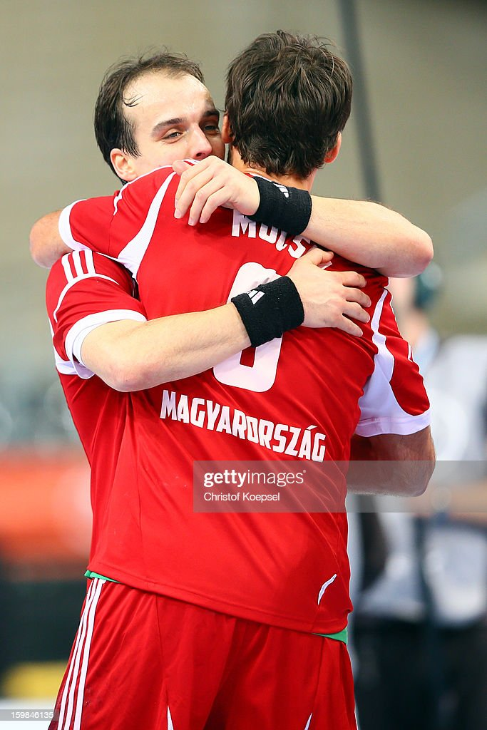 Gergely Harsanyi embraces Tamas Mocsai of Hungary after winning the round of sixteen match between Hungary and Poland at Palau Sant Jordi on January 21, 2013 in Barcelona, Spain. The match between Hungary and Poland ended 27-19.
