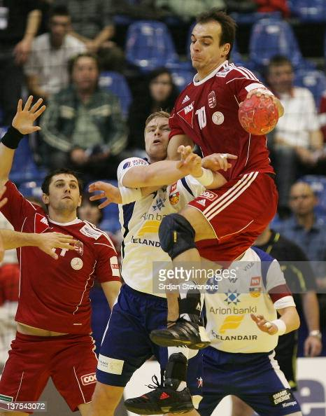 Gergely Harsanyi of Hungary vies with Aron Palmarsson of Iceland during the Men's European Handball Championship 2012 second round group two match...