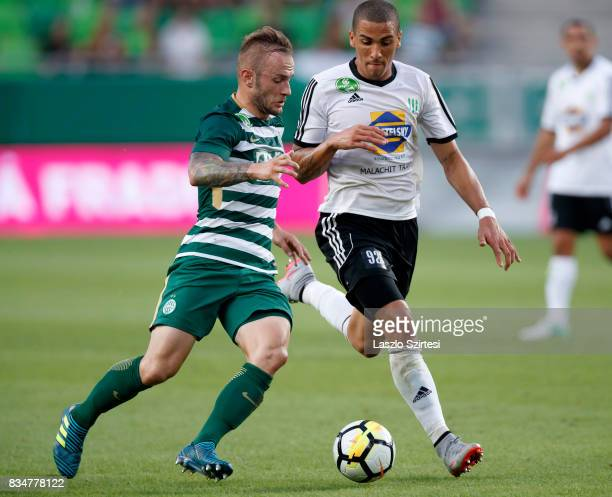 Gergo Lovrencsics of Ferencvarosi TC duels for the ball with Myke Bouard Ramos of Swietelsky Haladas during the Hungarian OTP Bank Liga match between...