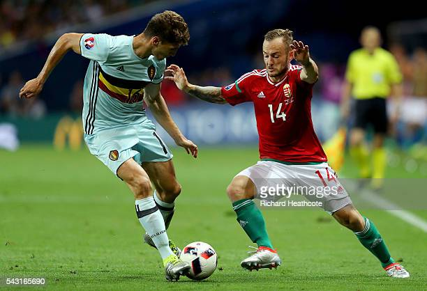 Gergo Lovrencsics of Hungary and Thomas Meunier of Belgium compete for the ball during the UEFA EURO 2016 round of 16 match between Hungary and...
