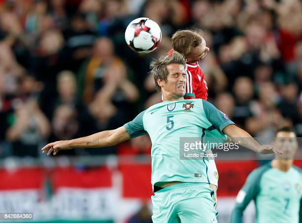 Gergo Lovrencsics of Hungary battles for the ball in the air with Fabio Coentrao of Portugal during the FIFA 2018 World Cup Qualifier match between...