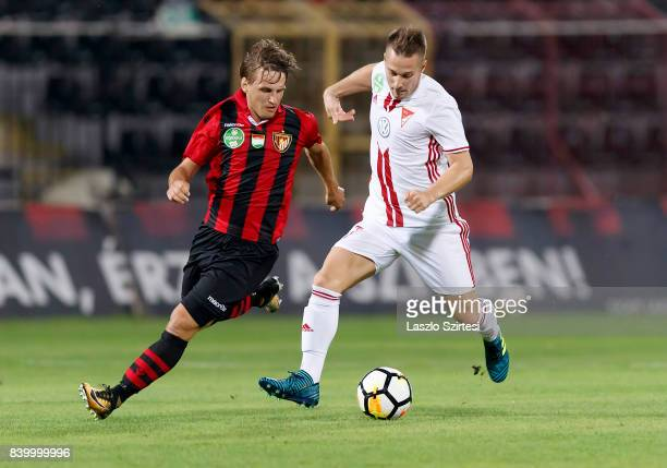Gergo Nagy of Budapest Honved competes for the ball with Adam Bodi of DVSC during the Hungarian OTP Bank Liga match between Budapest Honved and DVSC...