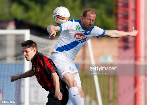 Gergo Nagy of Budapest Honved duels for the ball in the air with Sandor Torghelle of MTK Budapest during the Hungarian OTP Bank Liga match between...