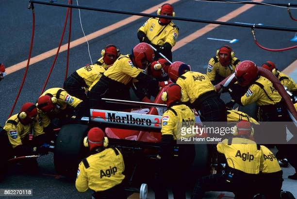 Gerhard Berger Ferrari 412T1B Grand Prix of Europe Circuito de Jerez 16 October 1994 Gerhard Berger makes a pit stop with his Ferrari 412T1B
