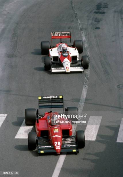 Gerhard Berger of Austria driving a Ferrari F1/87/88C with a Ferrari 033E 15 V6t engine for Scuderia Ferrari SpA SEFAC leads over Alain Prost in the...