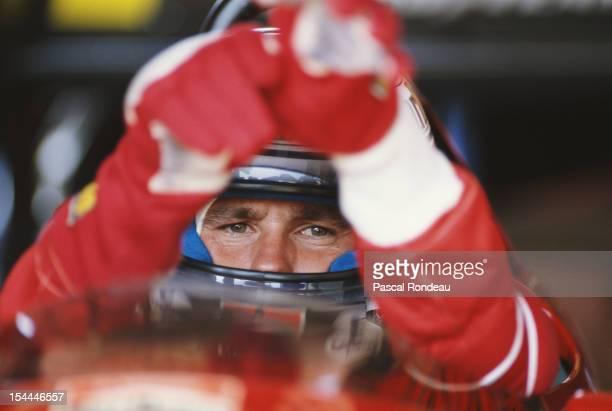 Gerhard Berger of Austria sits aboard the Scuderia Ferrari 640 Ferrari 035/5 35 V12 during practice for the Brazilian Grand Prix on 25th March 1989...