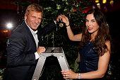 Gerhard Leinauer and Alexandra Polzin attend the Swarovski Christmas Party 2014 at Hotel Vier Jahreszeiten on November 27 2014 in Munich Germany