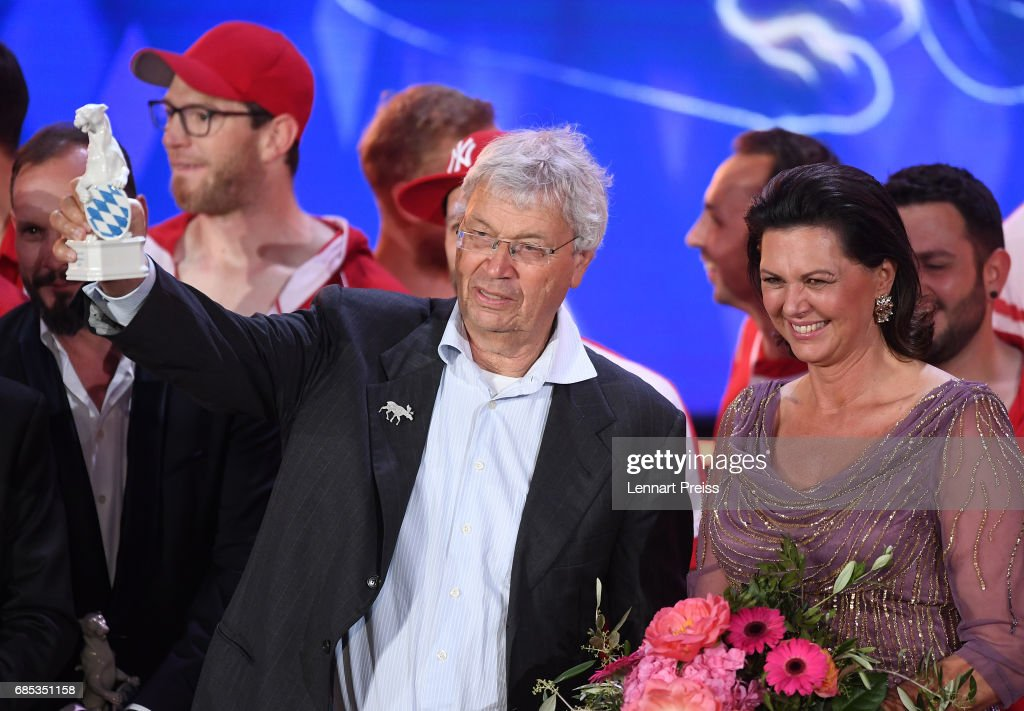 Gerhard Polt, winner of the Honorary Award, poses with his award next to Bavarian state minister Ilse Aigner during the Bayerischer Fernsehpreis 2017 show at Prinzregententheater on May 19, 2017 in Munich, Germany.