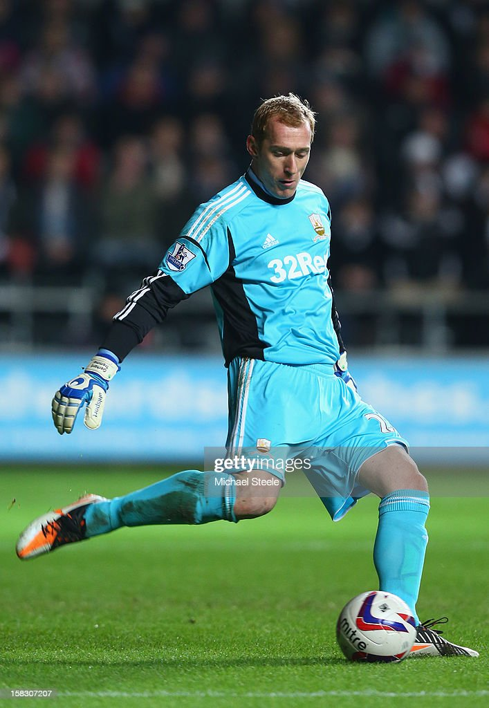 <a gi-track='captionPersonalityLinkClicked' href=/galleries/search?phrase=Gerhard+Tremmel&family=editorial&specificpeople=751125 ng-click='$event.stopPropagation()'>Gerhard Tremmel</a> of Swansea City in action during the Capital One Cup Quarter-Final match between Swansea City and Middlesbrough at the Liberty Stadium on December 12, 2012 in Swansea, Wales.