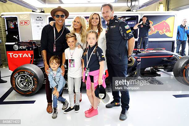 Geri Halliwell Jade Jones Emma Bunton and Red Bull Racing Team Principal Christian Horner stand in the Red Bull Racing garage before the Formula One...