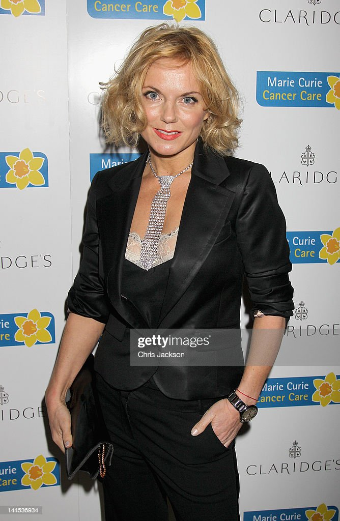 Geri Halliwell poses at the Marie Curie Cancer Care Fundraiser, hosted by Heather Kerzner at Claridge's Hotel on May 15, 2012 in London, England. Marie Curie Nurses provide free end of life care to patients with terminal illness in their own homes or in one of their nine hospices