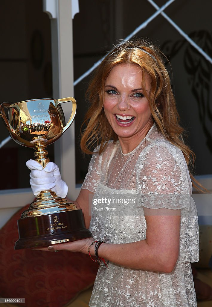 Geri Halliwell poses with the Melbourne Cup during Melbourne Cup Day at Flemington Racecourse on November 5, 2013 in Melbourne, Australia.