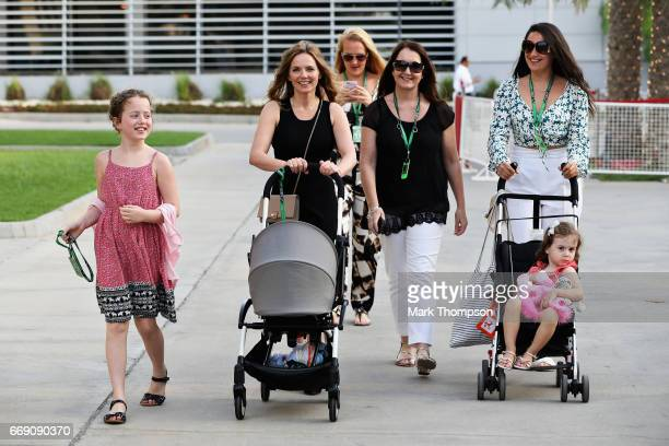 Geri Horner and children Bluebell Montague and Olivia walk in the Paddock before the Bahrain Formula One Grand Prix at Bahrain International Circuit...