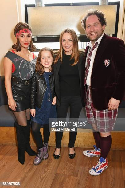 Geri Horner and daughter Bluebell Halliwell pose backstage with cast members Preeya Kalidas and Gary Trainor of the West End production of 'School Of...