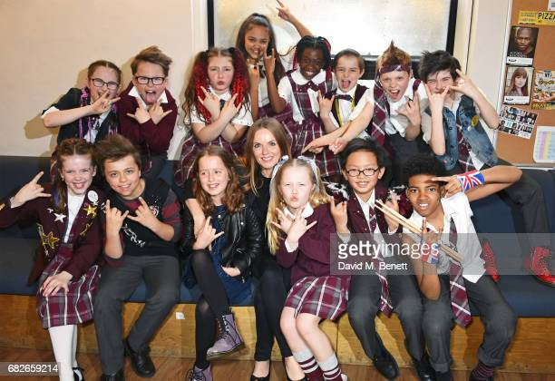 Geri Horner and daughter Bluebell Halliwell pose backstage with the young cast members of the West End production of 'School Of Rock The Musical' to...