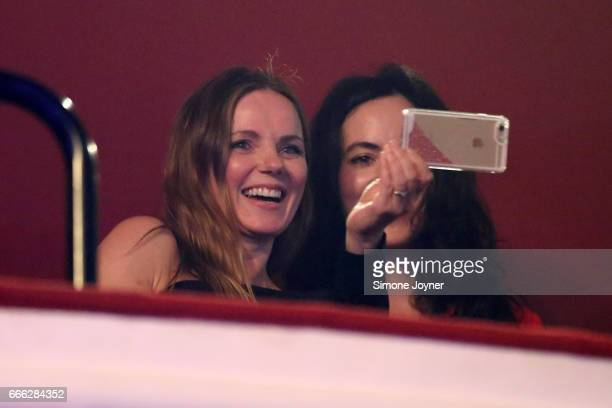 Geri Horner takes a photo on her smartphone as she watches Melanie C with Sally Wood at O2 Shepherd's Bush Empire on April 8 2017 in London England