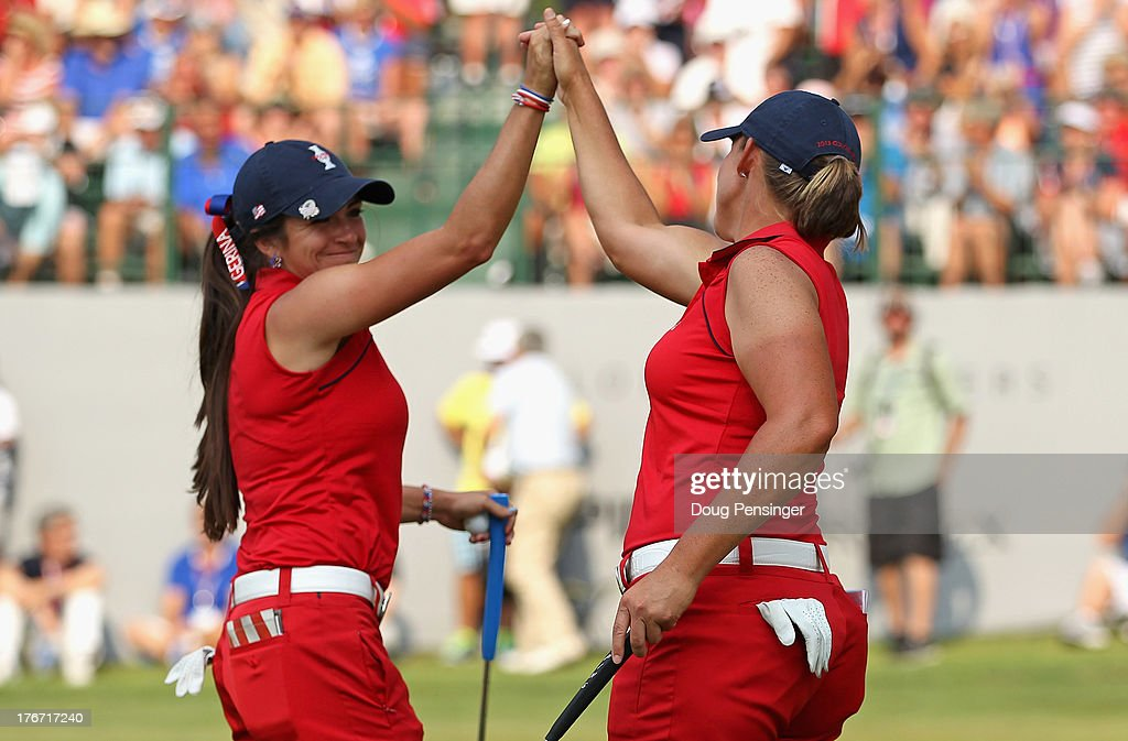 Gerina Piller and Angela Stanford of the United States Team celebrate after Piller made a birdie putt to win the 14th hole as they went on to be defeated by Carlota Ciganda of Spain and Azahara Munoz of Spain and the European Team by one hole during the afternoon four-ball matches at the 2013 Solheim Cup on August 17, 2013 at the Colorado Golf Club in Parker, Colorado.
