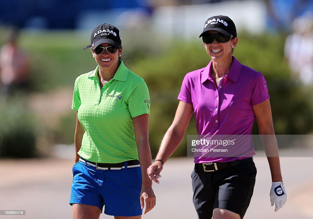 Gerina Piller and Nicole Castrale walk down the first hole during the final round of the RR Donnelley LPGA Founders Cup at Wildfire Golf Club on March 17, 2013 in Phoenix, Arizona.