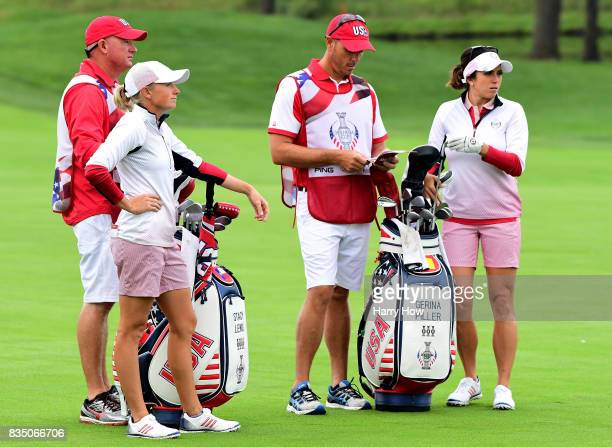 Gerina Piller and Stacy Lewis of the United States line up a second shot on the second green during the morning foursomes matches of the Solheim Cup...