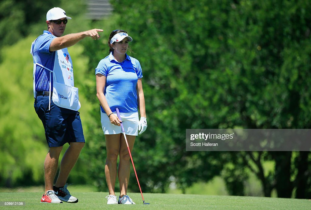Gerina Piller lines up a shot with her caddie Brian Dilley on the third hole during the final round of the Volunteers of America Texas Shootout at Las Colinas Country Club on May 1, 2016 in Irving, Texas.