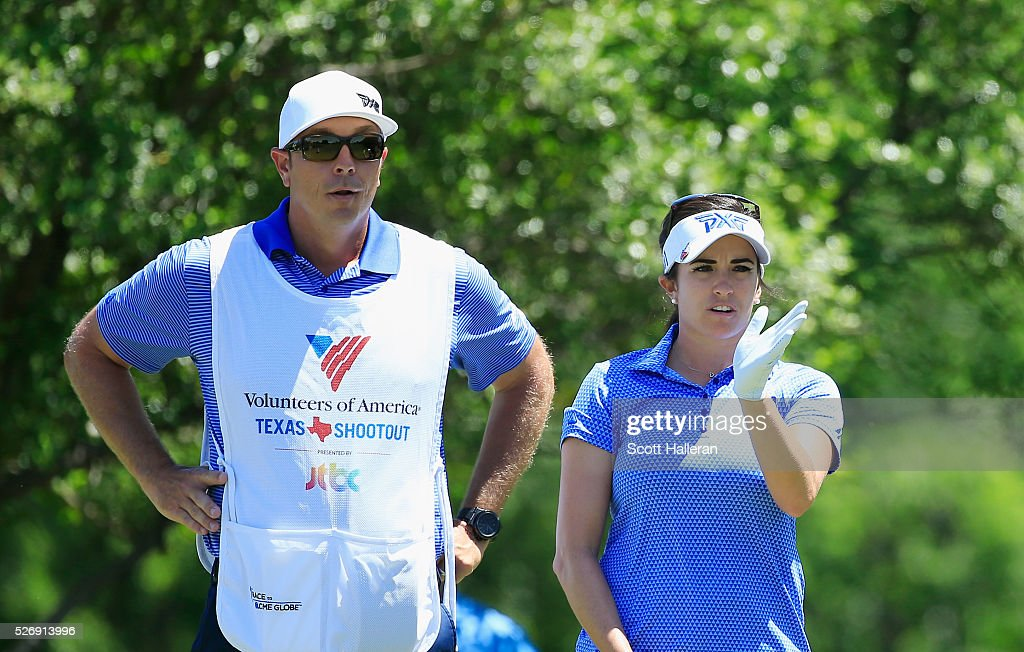 Gerina Piller lines up a shot with her caddie Brian Dilley on the seventh hole during the final round of the Volunteers of America Texas Shootout at Las Colinas Country Club on May 1, 2016 in Irving, Texas.