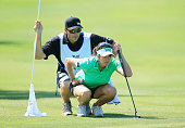 Gerina Piller looks over the tenth green with her caddie Brian Dilley during the third round of the Volunteers of America Texas Shootout at Las...