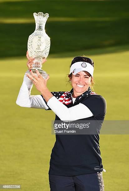 Gerina Piller of team USA holds the Solheim Cup trophy after the final day of The Solheim Cup at St LeonRot Golf Club on September 20 2015 in St...