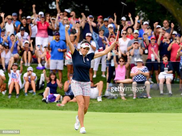 Gerina Piller of the United States celebrates her birdie to win her match four and two over Florentyna Parker of Team Europe during the final day...