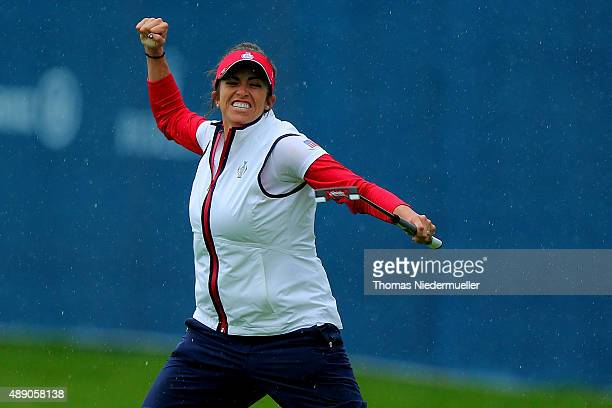 Gerina Piller of the United States Team celebrates at the 17th hole during the continuation of the afternoon fourball matches on day one of the...