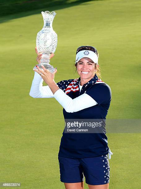 Gerina Piller of the United States Team proudly holds the Solheim Cup trophy after the closing ceremony during the final day singles matches in the...