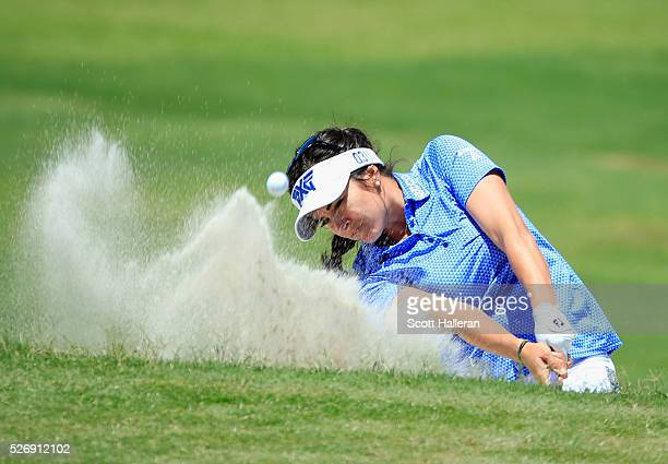 Gerina Piller plays a bunker shot on the third hole during the final round of the Volunteers of America Texas Shootout at Las Colinas Country Club on...