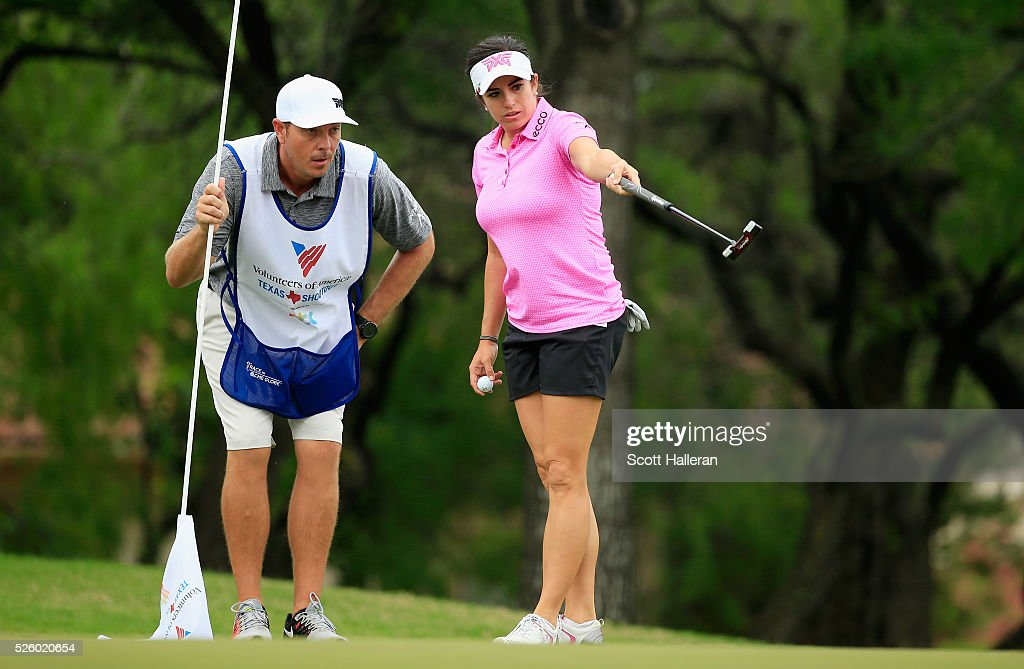 <a gi-track='captionPersonalityLinkClicked' href=/galleries/search?phrase=Gerina+Piller&family=editorial&specificpeople=7855082 ng-click='$event.stopPropagation()'>Gerina Piller</a> reads a putt with her caddie Brian Dilley on the second green during the second round of the Volunteers of America Texas Shootout at Las Colinas Country Club on April 29, 2016 in Irving, Texas.