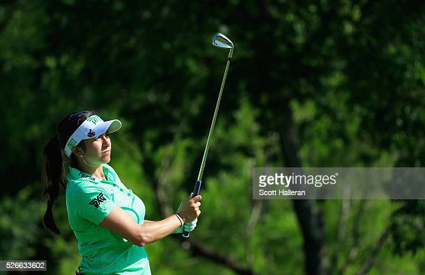 Gerina Piller watches her tee shot on the 13th hole during the third round of the Volunteers of America Texas Shootout at Las Colinas Country Club on...