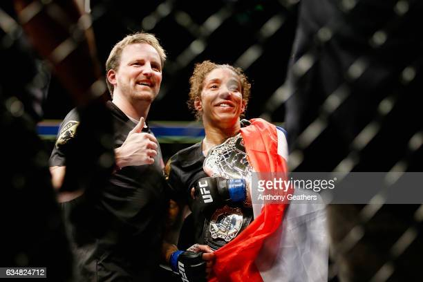 Germaine de Randamie of The Netherlands celebrates with the belt after defeating Holly Holm of United States in their UFC women's featherweight...