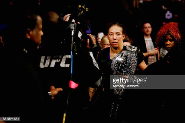 Germaine de Randamie of The Netherlands exits the Octagon with the belt after defeating Holly Holm of United States in their UFC women's...