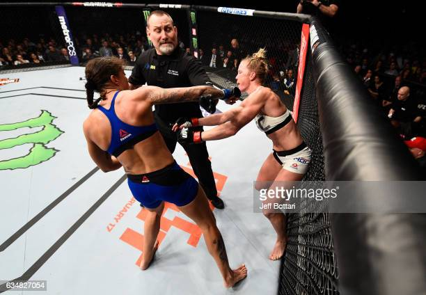 Germaine de Randamie of The Netherlands punches Holly Holm after the bell in their women's featherweight championship bout during the UFC 208 event...