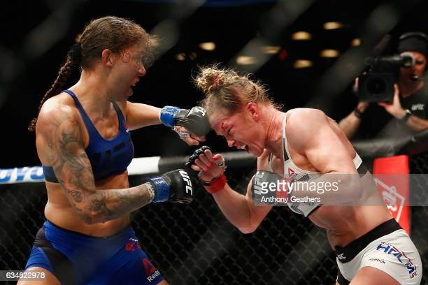 Germaine de Randamie of The Netherlands throws a punch against Holly Holm of United States in their UFC women's featherweight championship bout...