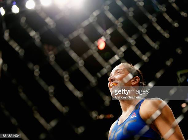 Germaine de Randamie of The Netherlands walks into the Octagon beefore fighting Holly Holm of United States in their UFC women's featherweight...