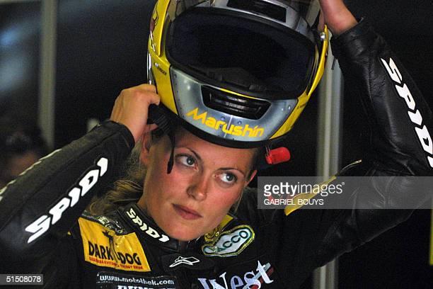 German 250cc Aprilia's rider Katja Poensgen adjusts her helmet during the Qualifying practice session of the 250cc class of the Italian Grand Prix 02...