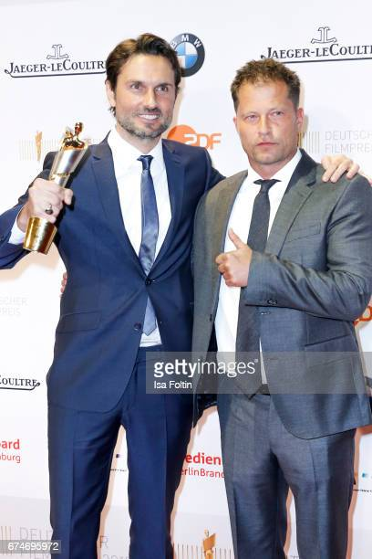 German actor and award winner for best film Simon Verhoeven and laudator and german actor Til Schweiger at the Lola German Film Award winners board...
