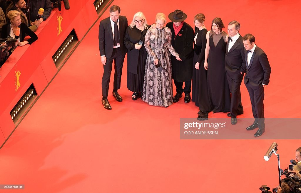 German actor and jury member Lars Eidinger, French photographer and jury member Brigitte Lacombe, US actress and jury president Meryl Streep, Dieter Kosslick, Italian actress and jury member Alba Rohrwacher, Polish film maker and jury member Malgorzata Szumowska and British film critic and jury member Nick James pose for photographers on the red carpet for the film 'Hail, Caesar!' screening as opening film of the 66th Berlinale Film Festival in Berlin on February 11, 2016. Eighteen pictures will vie for the Golden Bear top prize at the event which runs from February 11 to 21, 2016. / AFP / ODD ANDERSEN