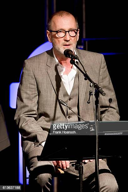 German actor and singer Peter Lohmeyer performs live during a concert with 'Club der toten Dichter' at the Postbahnhof on October 9 2016 in Berlin...